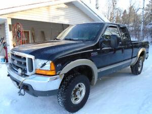Ford Lariat SLT 4x4 three quarter t truck
