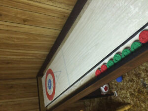 Shuffle board table with new rocks