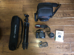 Canon Rebel t3 Camera with kit lens and tripod