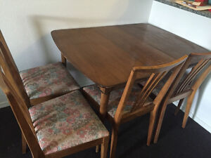 One dining table with 4 chairs.