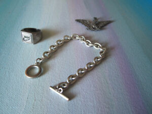 Silver bracelet, Nike ring and  eagle