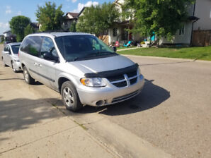 2005 DODGE GRAND CARAVAN WITH STOWE AND GO SEATS