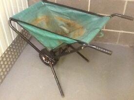 Fold away wheelbarrow.