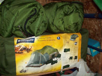 Like new, 8 person tent with rain fly and a carry bag!