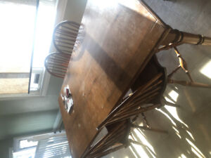 Solid wood dinning table with matching chairs