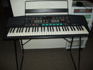 Yamaha PSR-48 Keyboard with power adapter and stand.