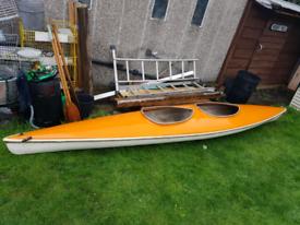 Two person fiberglass body canoe
