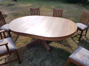 Beautiful solid old/vintage table with 6 chairs.  $400