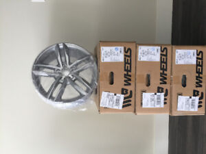 A set of 99% new 225/50/R17 tires and wheels