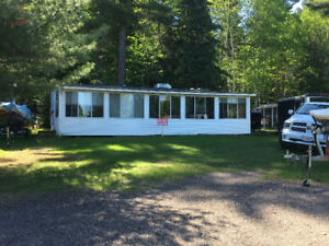 40ft Parked Model Trailer with 10X40 Addition-White Pine Lodge