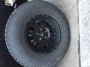 Pro comp rims and toyo tires
