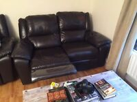 Two seater dark brother leather settee