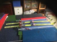 A Pair Of ski's and walking sticks.
