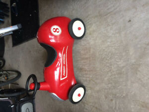 Antique looking radio flyer ride along toy