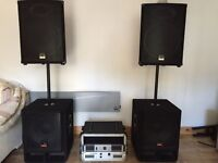 Wharfedale PA speakers and subs with two amps in rack and cables
