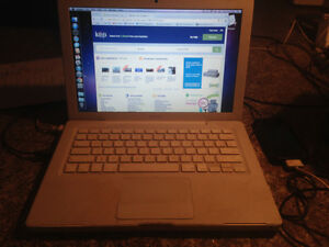 APPLEMACBOOK 2009...NO SCRAPES OR CRACKS...RUNS WELL ...SOMETIME