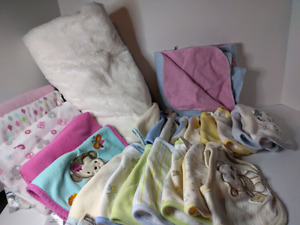 More then 12 bibs,5 blankets, one big soft cotton blanket
