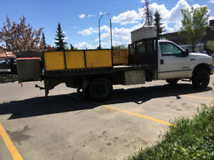 1999 Ford F450 with mortar mixer attached