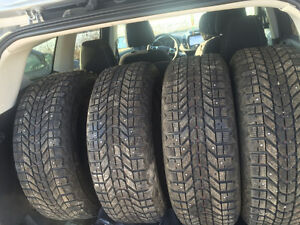 Firestone winter force studded tires on rims