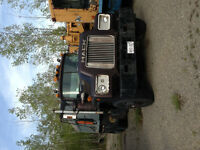 Dump truck and Gradall for sale