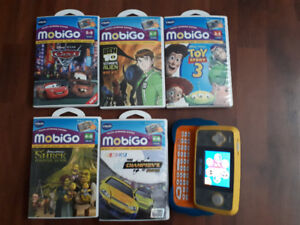 MobiGo Touch Learning System and 6 cartridges (Video games).