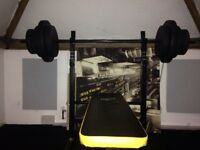 Bench with barbell and 50KG's of weight