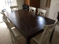 Ikea Bjursta black-brown table with 6 white dining chairs