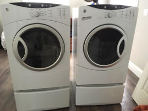 GE Washer and Dryer on pedestals