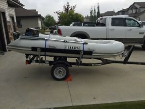 12' TITAN INFLATABLE BOAT COMPLETE WITH 2 MOTORS