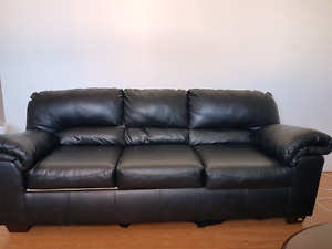 2 Ashley faux leather couches