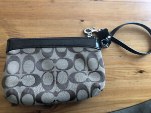 Lightly used coach wristlet, brown and beige