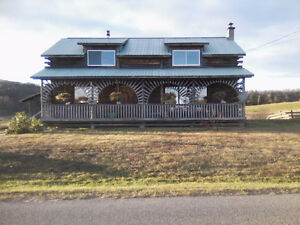 Country log home for sale