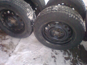 Uniroyal Tiger Paw 215/65/17 snow tires on rims
