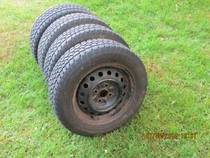 4 winter tires & rims  185 65 R14