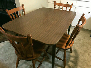 Dining table and three chairs