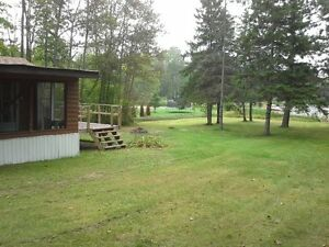 Camp on beautiful level lot in French River