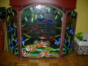 Stained glass dragonfly design tri folding fireplace screen.