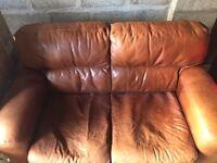 Tan leather sofa and armchair.