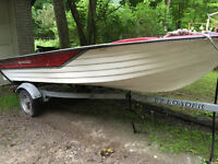 REDUCED!! 14' boat +  trailer (new) + 15HP motor