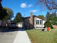 NORTH SARNIA BRICK BUNGALOW. DOUBLE DETACHED GARAGE!