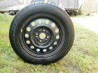 4 Bolt Rim and Michelin Tire 175/65/14 in excellent condition.