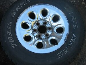 4 - 265/70/17 TIRES AND RIMS  CHEV / GMC