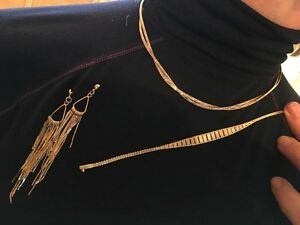 Gold necklaces, Bracelets, and earrings