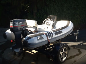 11 .FT. BOAT WITH 30 HP MOTOR