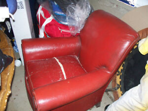 Beautiful old arm Leather Antique Chair has coil springs