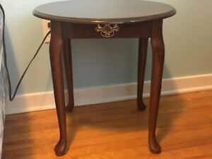 Two small side tables with rounded feet and elegant handles