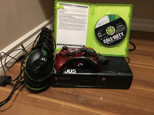 Xbox 360 with one game and head phone