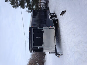 Two place enclosed sled trailer