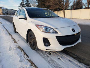 2012 Mazda 3 with winter tires, rims, stereo. Clean and low KM