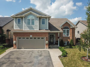 EXQUISITE RAISED RANCH IN SMITHVILLE... WITH BACKYARD OASIS!